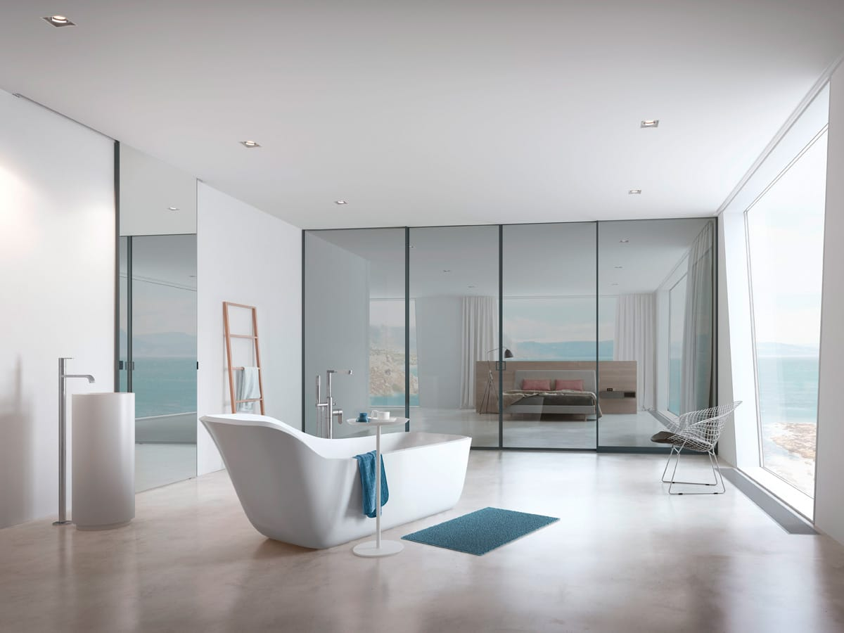 Portes coulissantes en guise de paroi de séparation dans la salle de bains